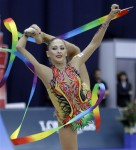 Russia's Daria Kondakova performs with a ribbon during the Individual All-Around finals at the 30th rhythmic gymnastics world championships in Moscow, Thursday, Sept., 23, 2010. (AP Photo/Sergey Ponomarev)